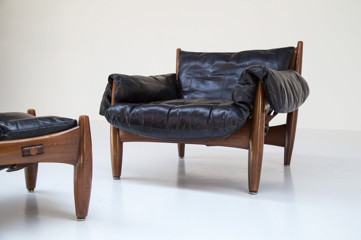 Sergio Rodrigues 'Sheriff' chair and ottoman.