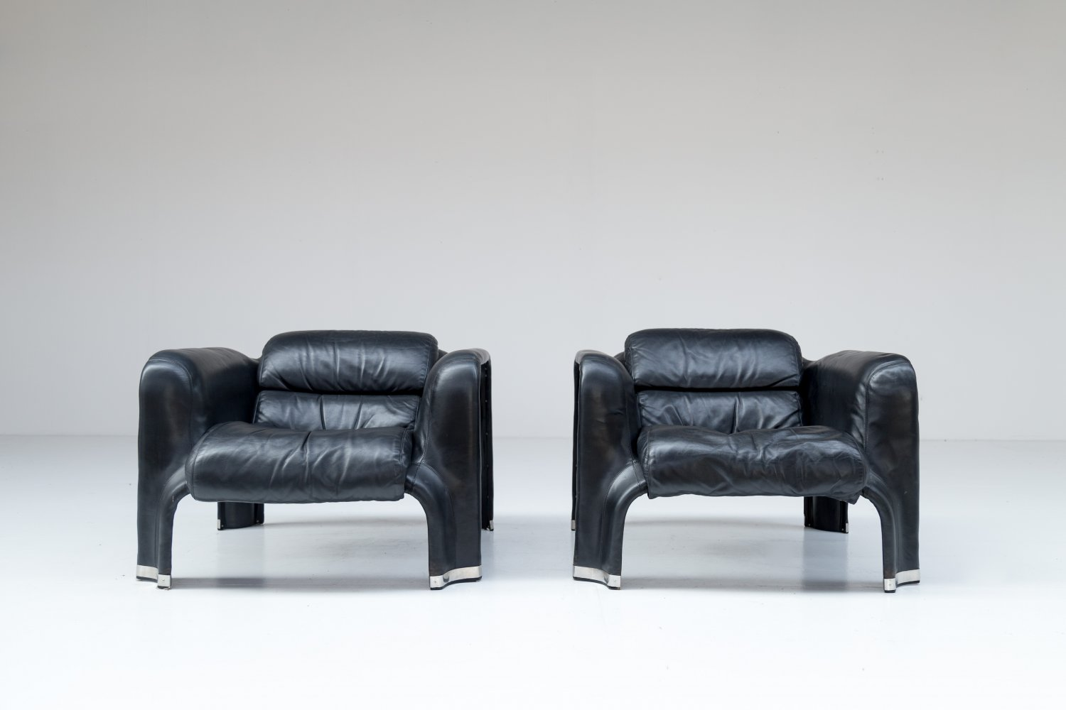 Pair of black leather Pohjola chairs by Pekka Perjo for Haimi Finland.