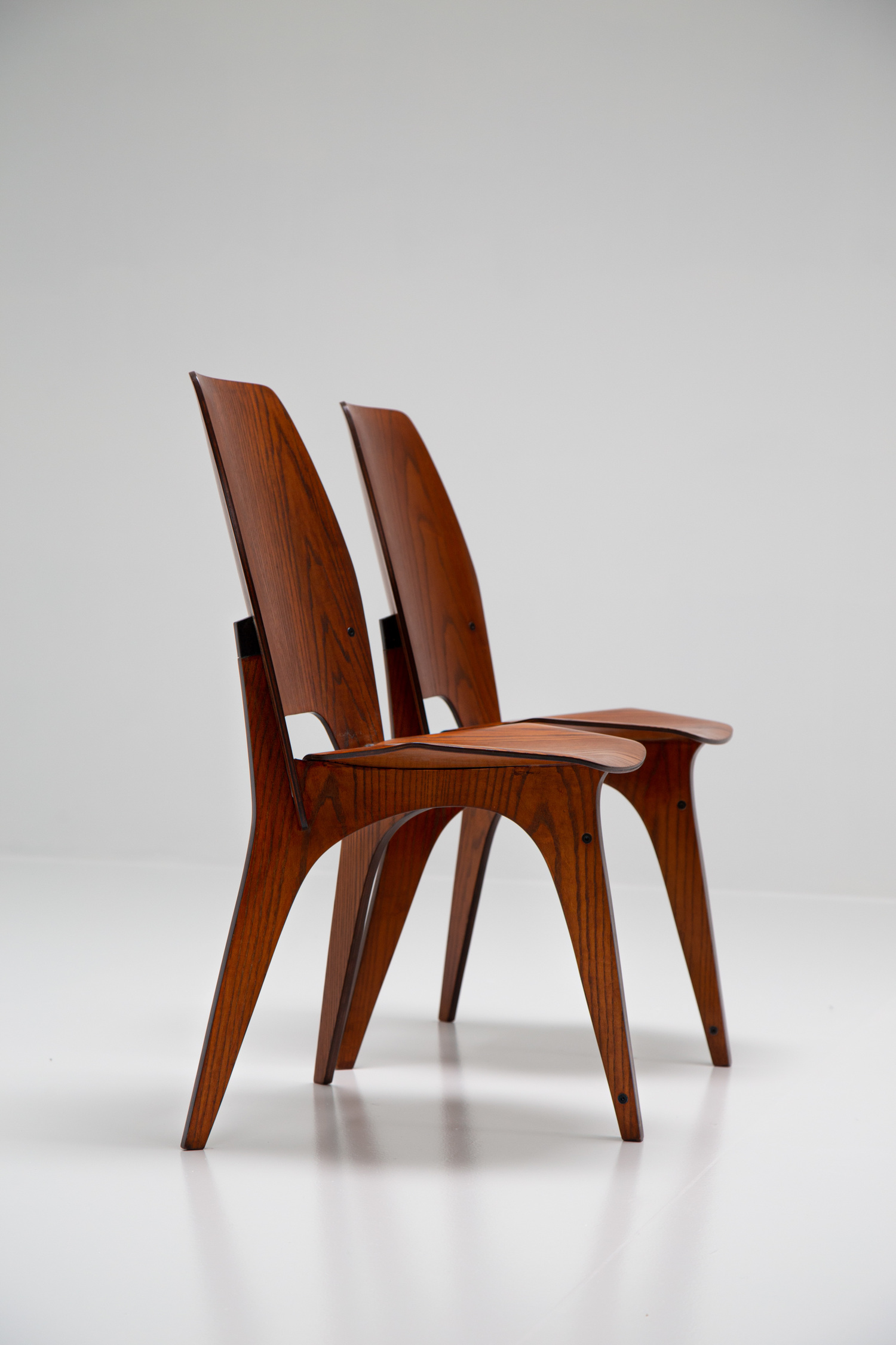Pair of chairs by Eugenio Gerli for Tecno