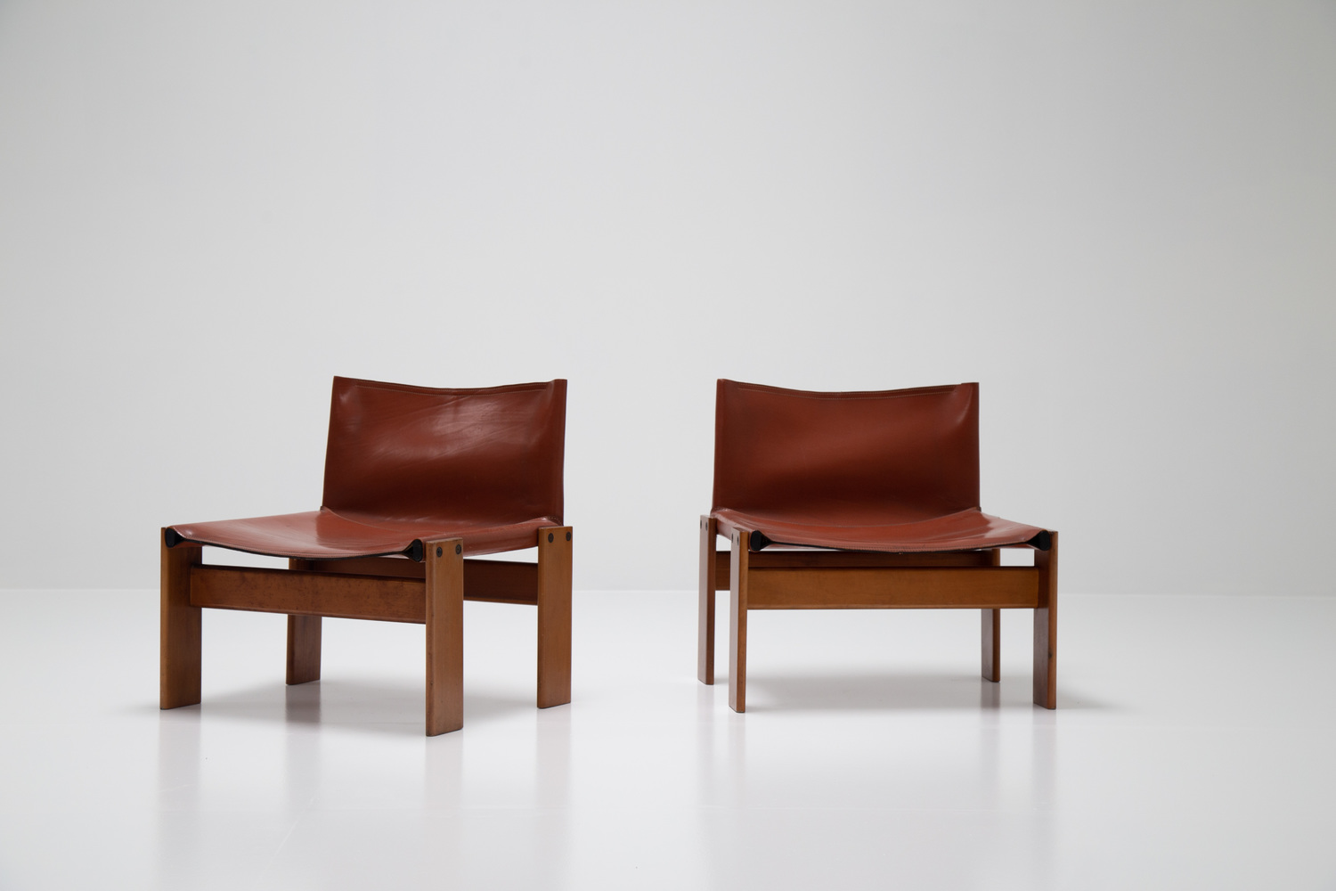 Pair of low 'Monk' chairs by Afra & Tobia Scarpa
